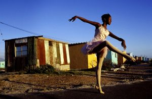 Ballet dancer strikes a pose outside her home in Khayelitsha, So